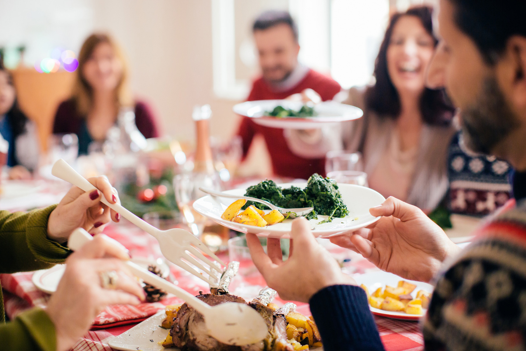 Family eating and chatting at holiday table