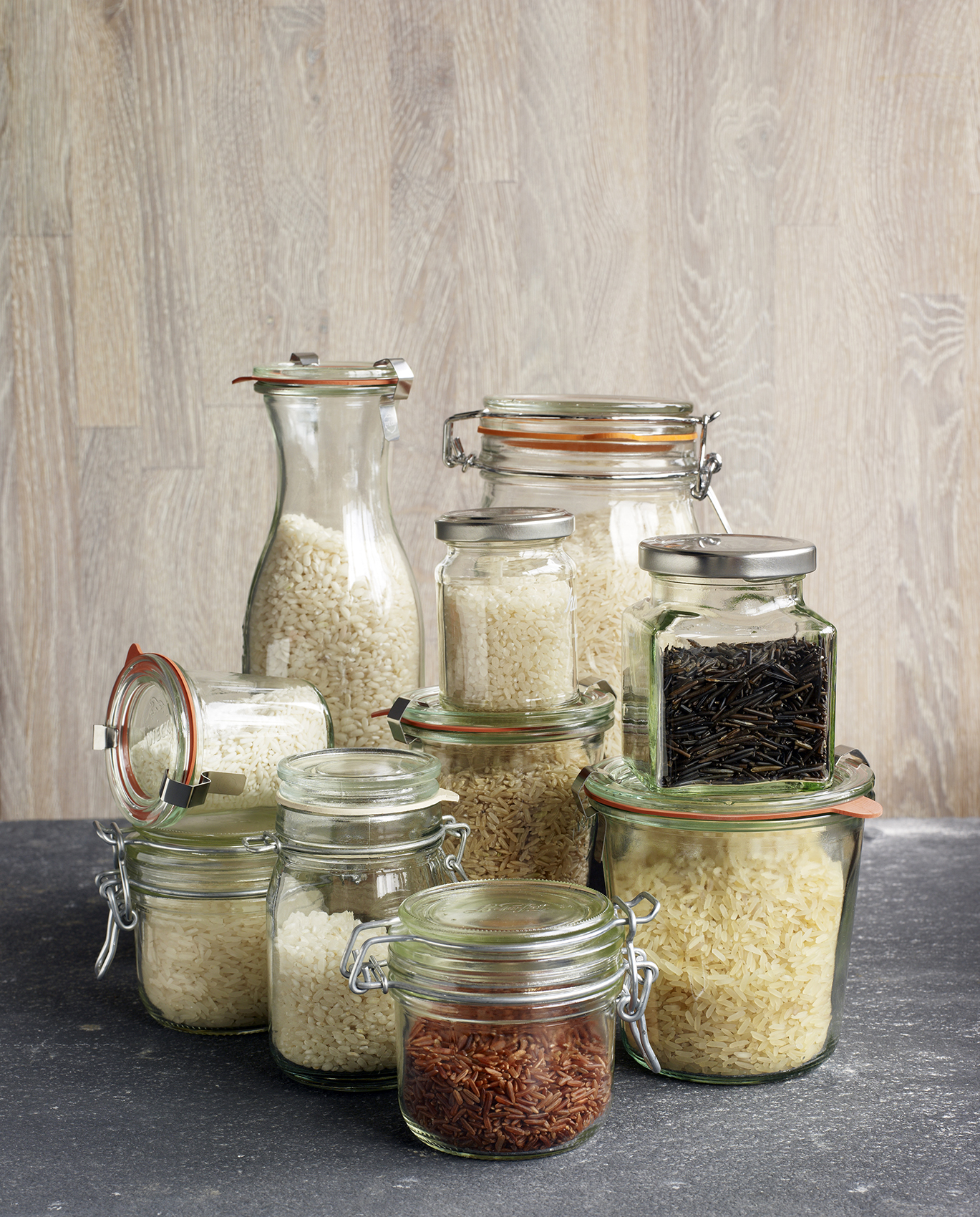 Glass jars containing different types of rice