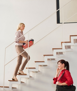 Woman climbing stairs in office