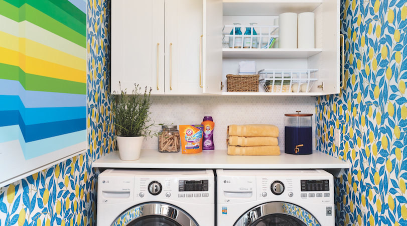 Real Simple Home organized laundry room with floral wallpaper