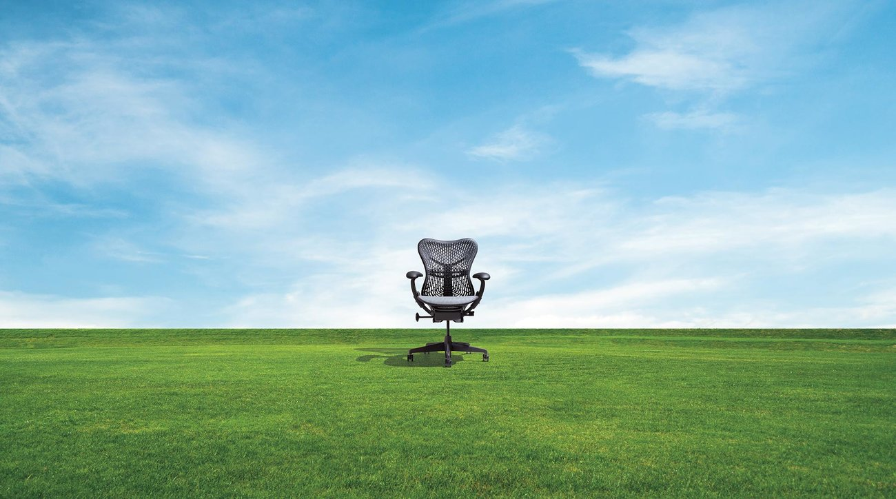 Desk chair in grass field
