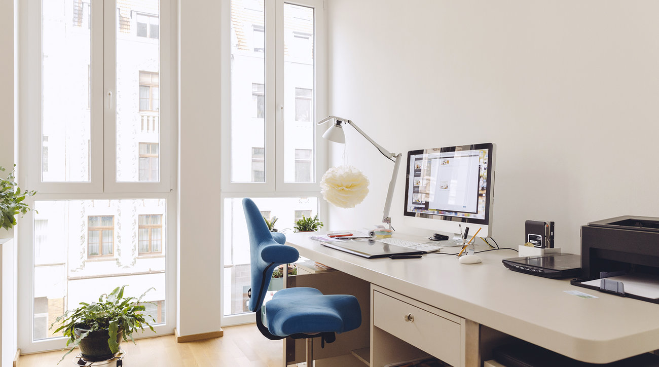 Home office space with blue chair