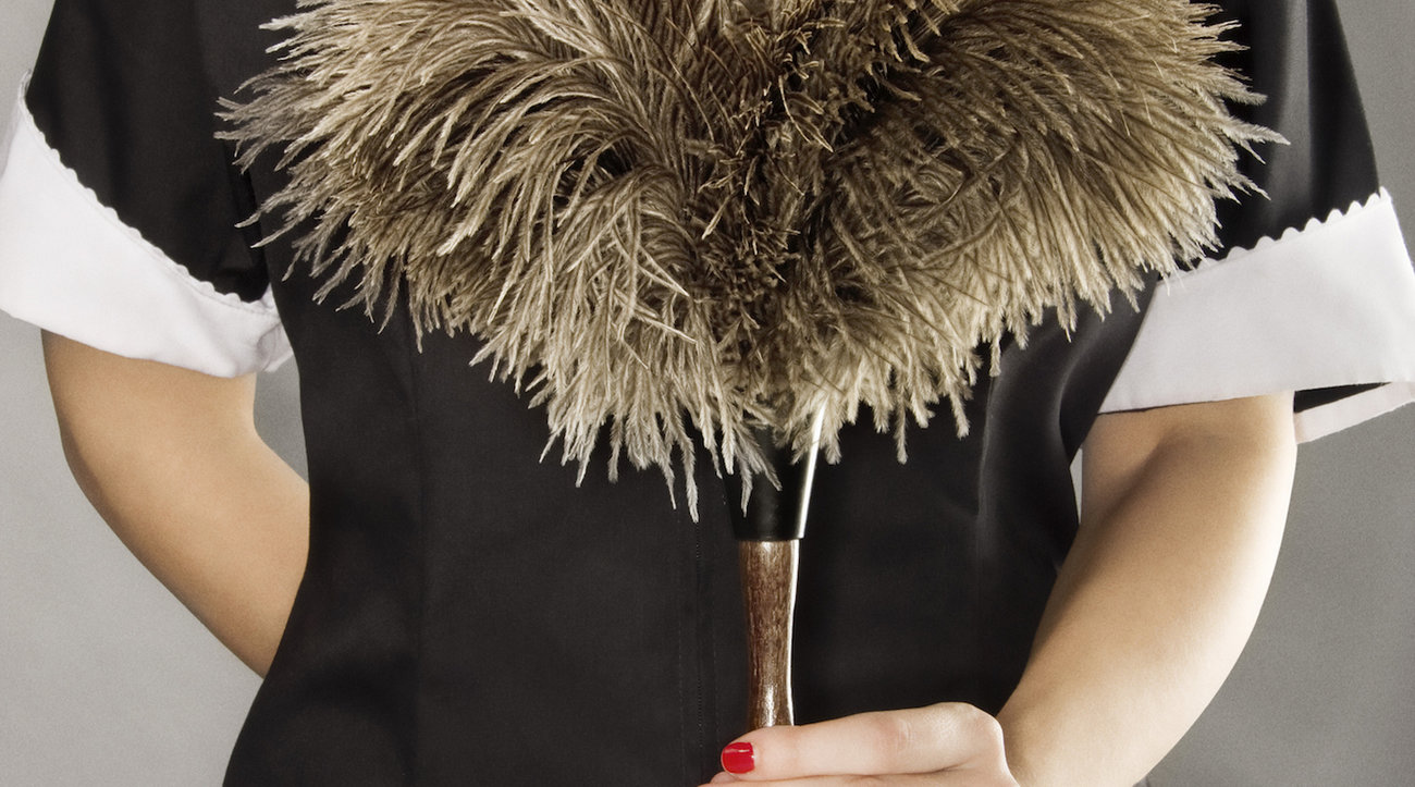 Housekeeper holding feather duster