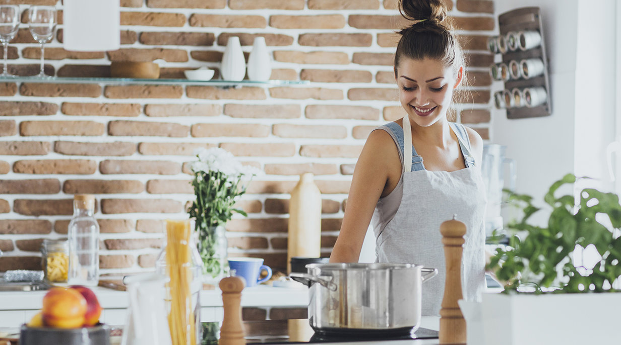 Woman Smiling to Herself in the Kitchen