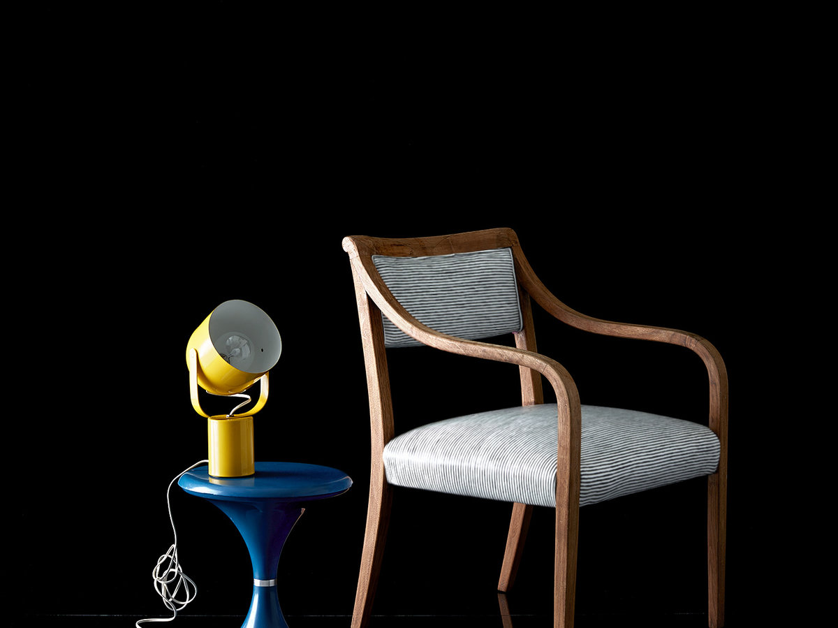 Chair and lamp on black