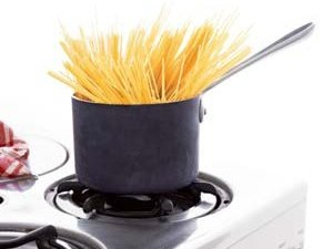 Pasta in a small pot on a stove
