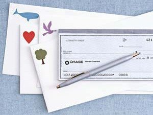 Checkbook on top of envelopes