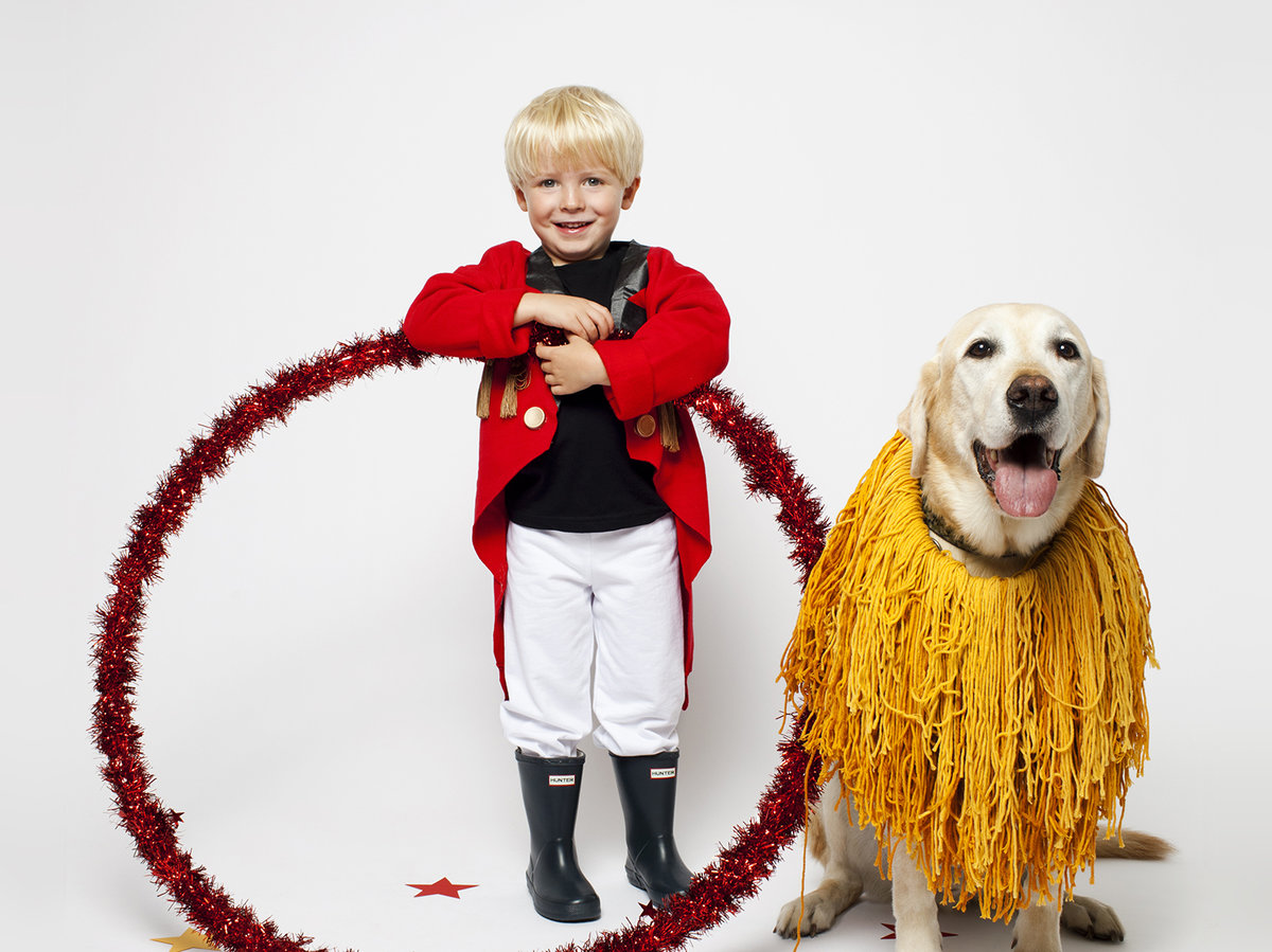 Boy and dog in lion tamer costumes