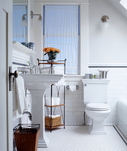 White bathroom with orange flowers