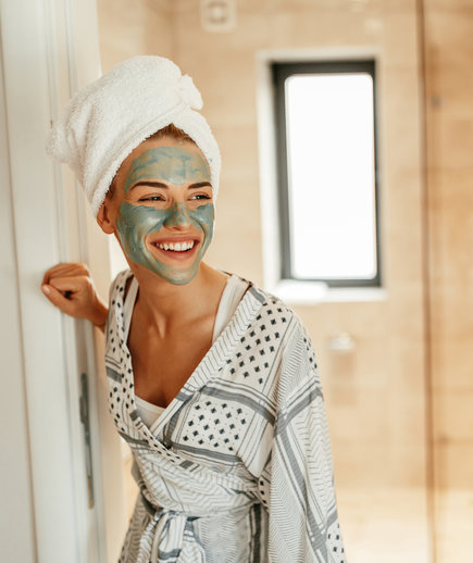 A Woman Using a Face Mask or Peel in Her Skin-Care Routine