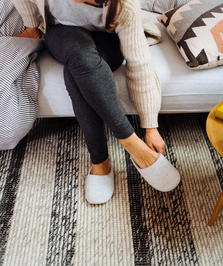 Cozy Home Hacks, Women putting on slippers
