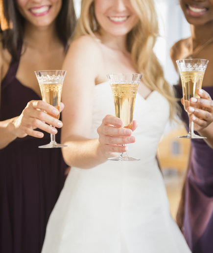 Bridesmaids and bride toasting with champagne.