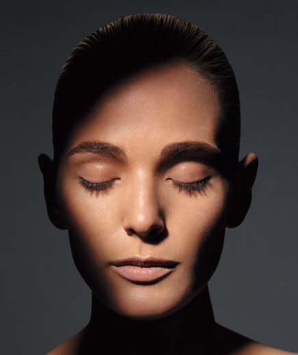 Headshot of model with eyes closed