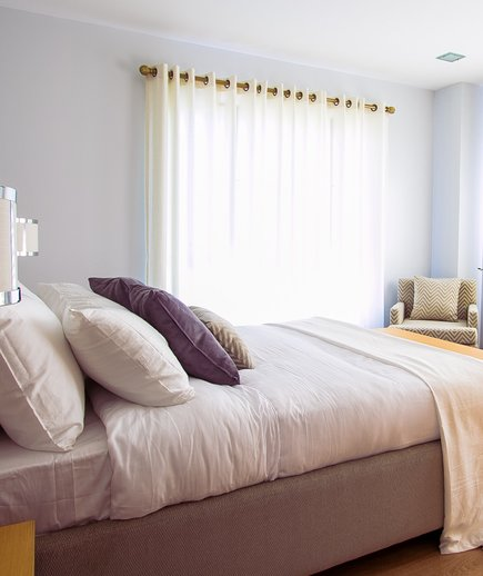 Colorful room with pale yellow curtains