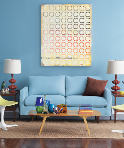Blue living room with yellow chairs and blue sofa