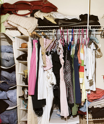 Clothes in messy closet