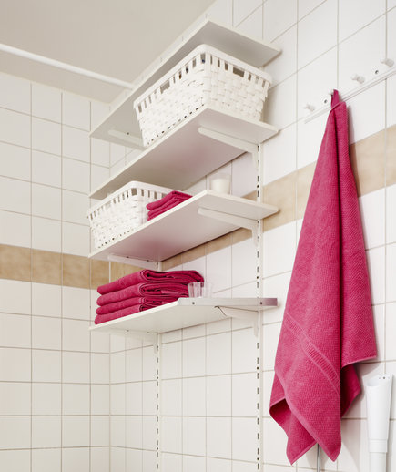 Bathroom with high shelves and storage bins
