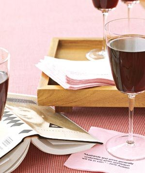 Glass of red wine on a pink napkin