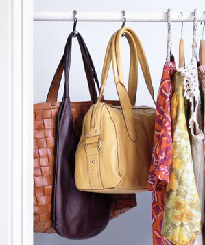 Purses Hung From Shower Curtain Hooks