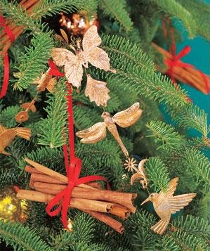 Metal garland and cinnamon sticks as Christmas tree decorations