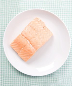 Salmon raw on plate