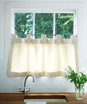 short curtain hanging from rail on lower part of kitchen window - Hanging Drapery