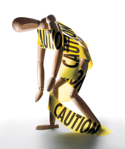 wooden-figure-model-caution-tape
