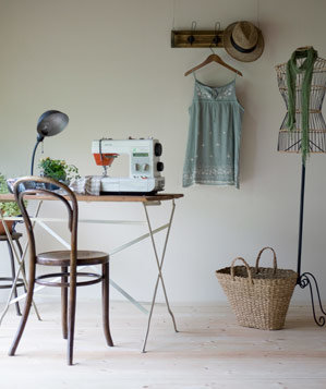 Sewing room with sewing machine, basket and dress form