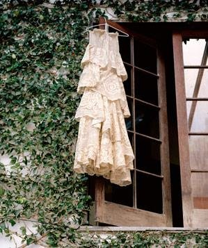 Vintage dress hanging from window