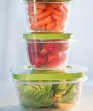 Carrots, strawberries and salad in plastic containers