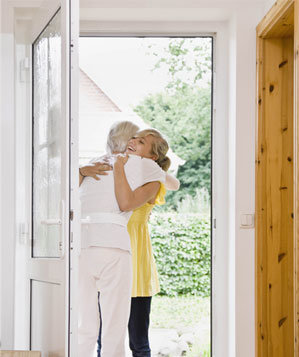 Woman hugging her host at the door
