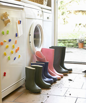 Rain boots lined up by a side door