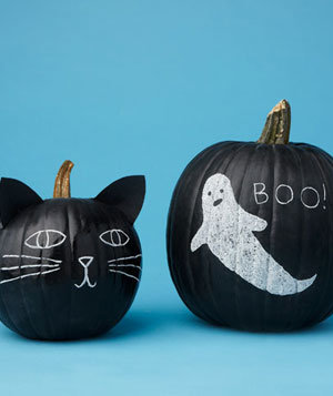 Black pumpkins with chalk drawings