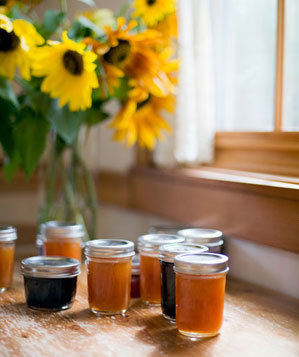 Jars of homemade jam with sunflowers