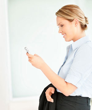Business woman reading a text message