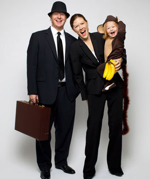 Boy and his parents in monkey business costumes