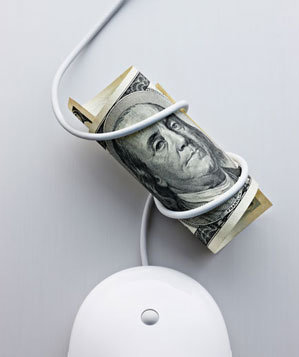 Computer mouse wrapped around hundred dollar bill
