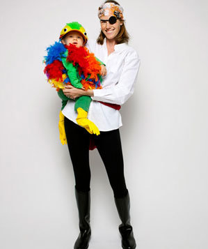 Mother in pirate costume with child in parrot costume
