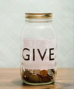 Glass penny jar with word GIVE written on it