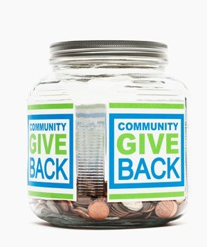"Jar of pennies with ""Community Give Back"" sticker"