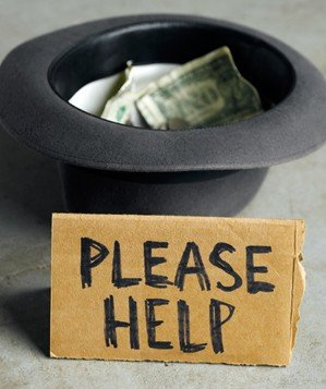 "Hat collecting money behind sign that says ""Please Help"""