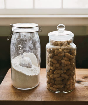 Two clear jars filled with peanuts and flour