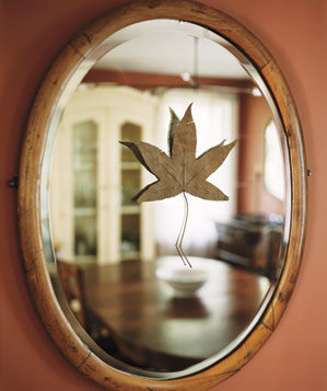 Leaf taped to a mirror