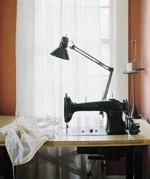 Sewing machine in front of window