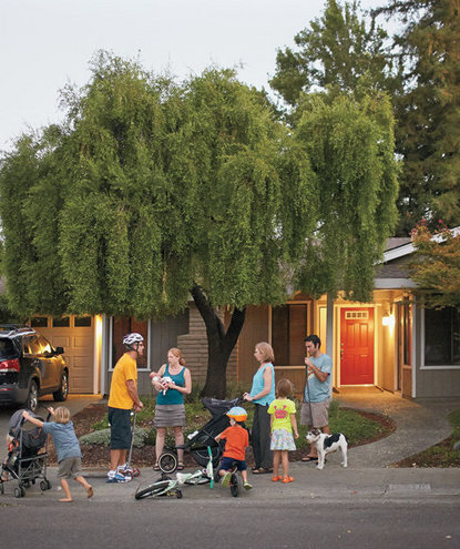family-standing-front-yard