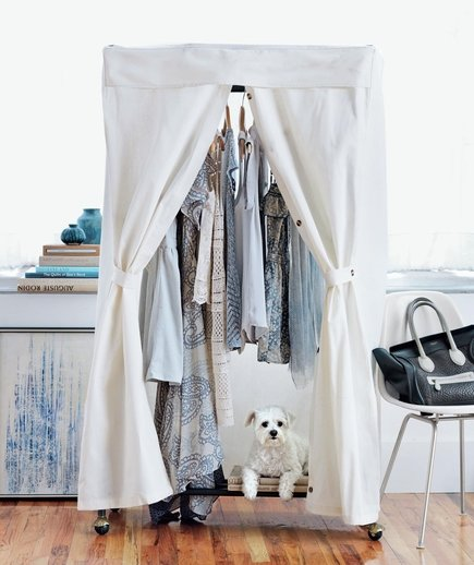 wardrobe-rack-dog-white-room-blue-accents