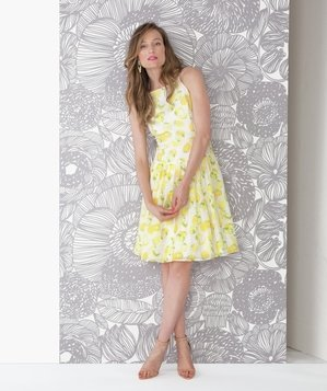 Model wearing yellow floral dress