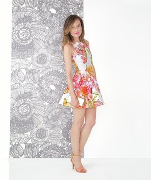 Model wearing bright floral dress