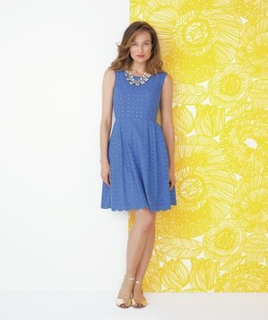 Model wearing blue eyelet dress