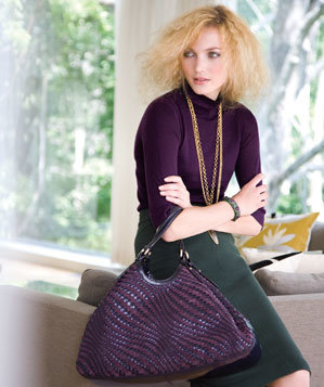 Model with jewel-tone handbag